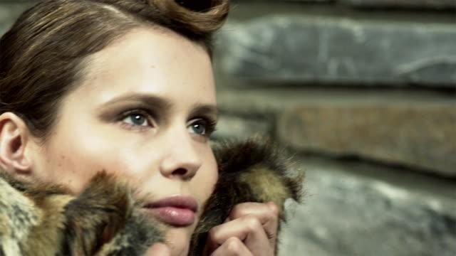 Young woman wearing fur coat