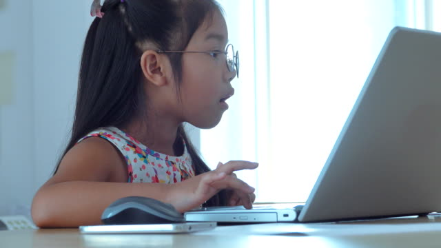young woman wearing glasses using computer - primary age child stock videos & royalty-free footage