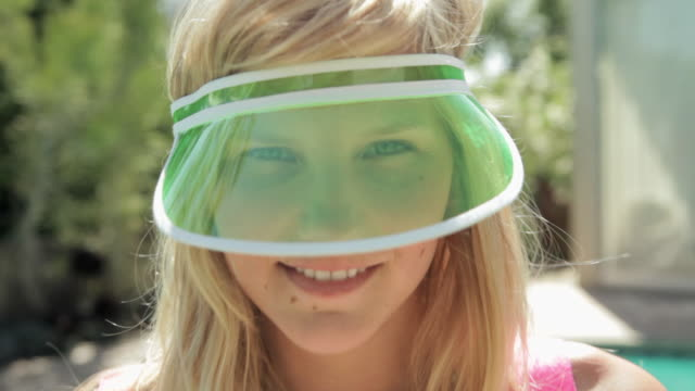 young woman wearing green sun visor - sun visor stock videos and b-roll footage