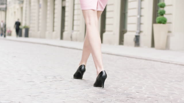 young woman wearing heels walking in the city. close up on legs - high heels stairs stock videos & royalty-free footage
