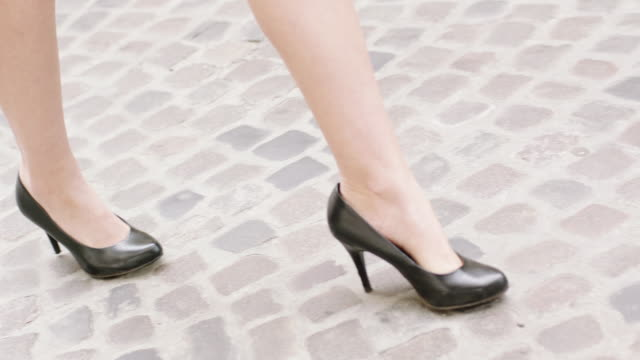 young woman wearing heels walking in the city. close up on legs - steps stock videos and b-roll footage