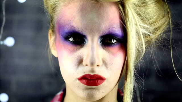 young woman wearing make-up - stage make up stock videos and b-roll footage