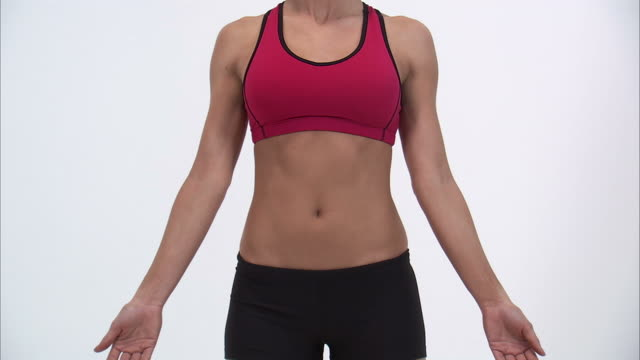 MS Young woman wearing sports bra, mid section / Orem, Utah, USA