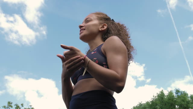 young woman wearing sports bra - sports bra stock videos & royalty-free footage
