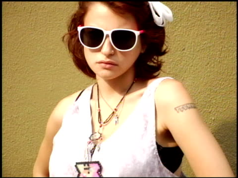 young woman wearing white romper with boots white hair bow sunglasses and costume jewelry - body adornment stock videos and b-roll footage