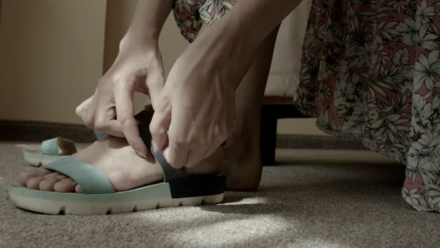 young woman wears sandals at home - sandal stock videos and b-roll footage