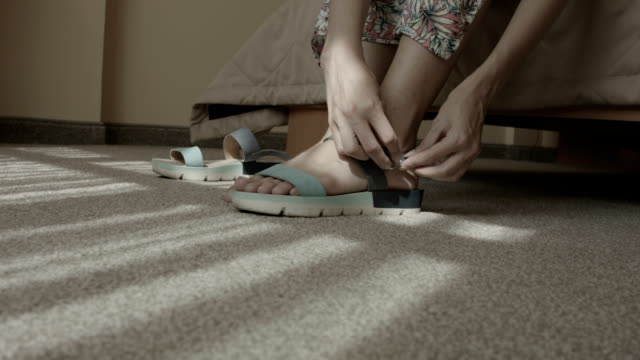 young woman wears sandals at home - sandal stock videos & royalty-free footage