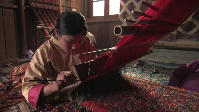 young woman weaving traditional cloth. - bhutan stock videos & royalty-free footage