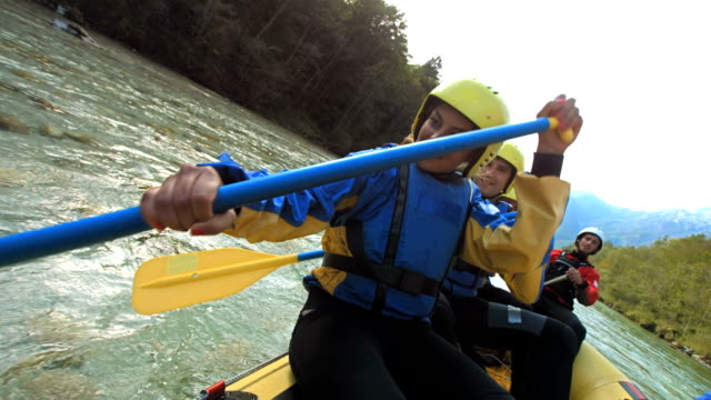 hd slow motion: young woman whitewater rafting - inflatable raft stock videos and b-roll footage