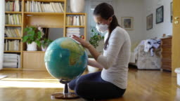 Young woman wiping the planet Earth