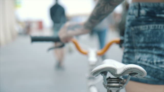 young woman with a bicycle - tattoo stock videos & royalty-free footage