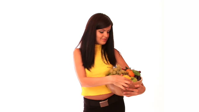 hd: young woman with a fruit basket - fruit bowl stock videos & royalty-free footage