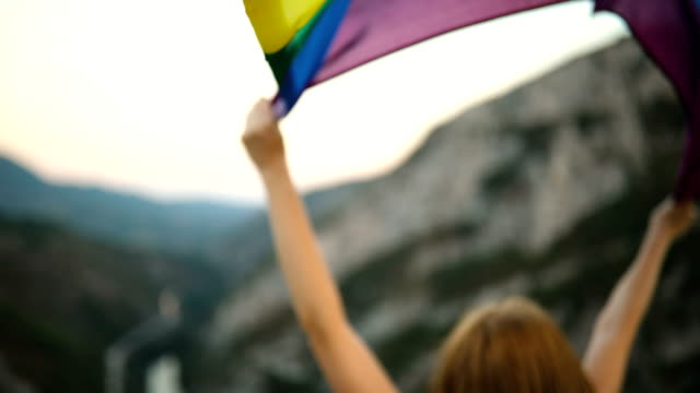 Young woman with a rainbow flag