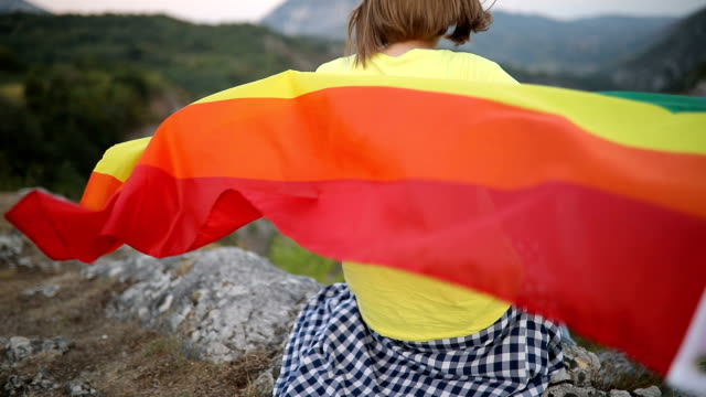 young woman with a rainbow flag - sex discrimination stock videos & royalty-free footage