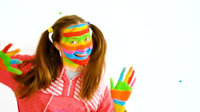 young woman with art makeup in rainbow colors - body adornment stock videos and b-roll footage