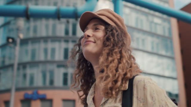 young woman with backpack and hat in central berlin - germany stock videos & royalty-free footage