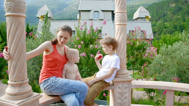 young woman with children in summer gazebo - gazebo stock videos & royalty-free footage