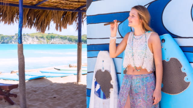 ms young woman with cigar at tropical beach - cigar stock videos and b-roll footage
