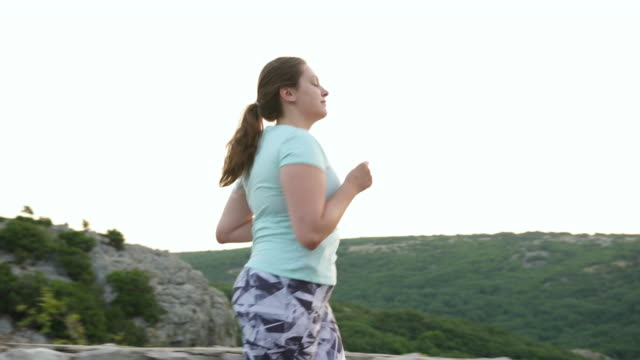 young woman with diabetes running outdoors - type 1 diabetes stock videos & royalty-free footage