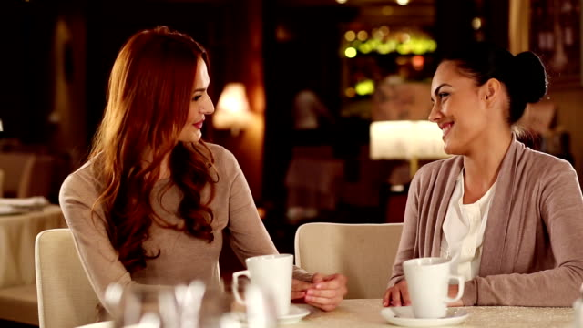 young woman with friend in a restaurant - redhead stock videos & royalty-free footage