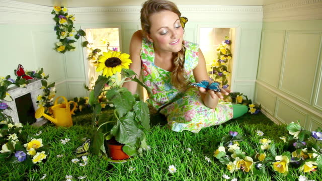 young woman with garden in small room - trapped stock videos & royalty-free footage