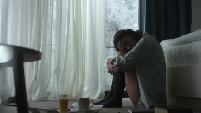 young woman with head down - the morning after stock videos and b-roll footage