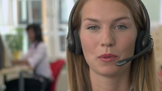 CU, SELECTIVE FOCUS, Young woman with headset in call center