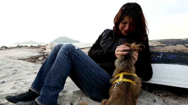 Young woman with her cute pekingese