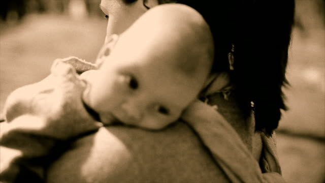 Young woman with her little baby OLD VIDEO EFFECT