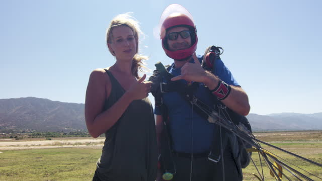 young woman with her tandem skydiving instructor - caucasian appearance stock videos & royalty-free footage
