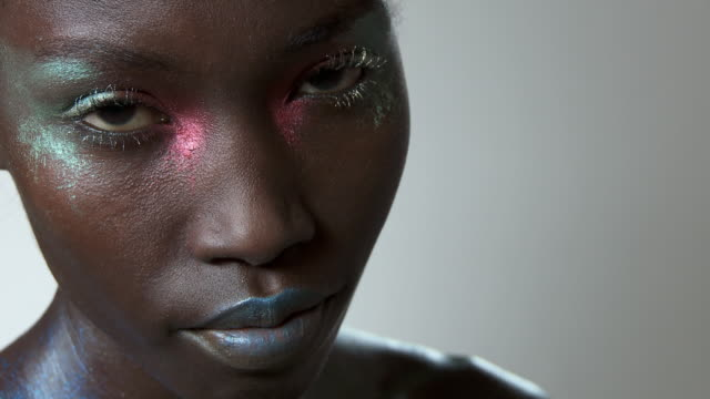 Young woman with metallic make up on face