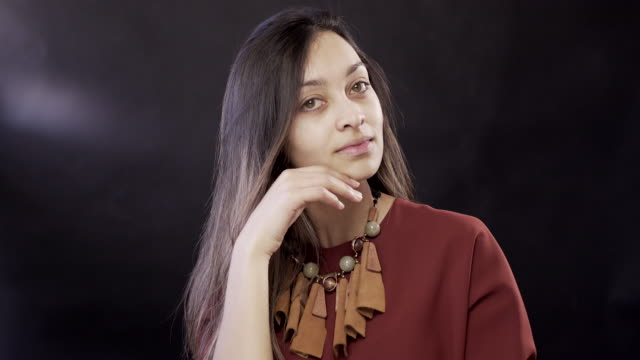 a young woman with no make-up on a black background - no make up stock videos & royalty-free footage