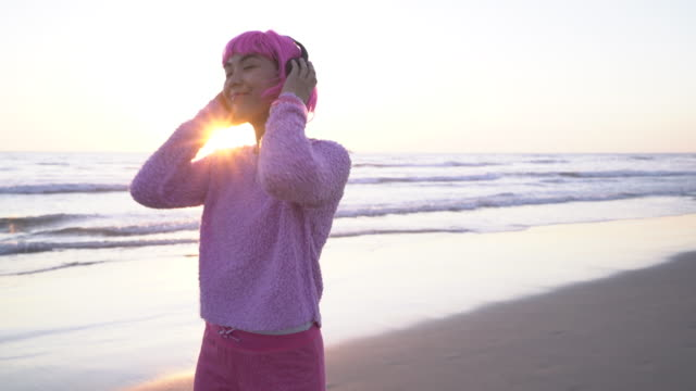 ms young woman with pink hair dancing on the beach - pink hair stock videos & royalty-free footage
