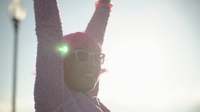 ms sm young woman with pink hair having fun in the sun. - sunglasses stock videos & royalty-free footage
