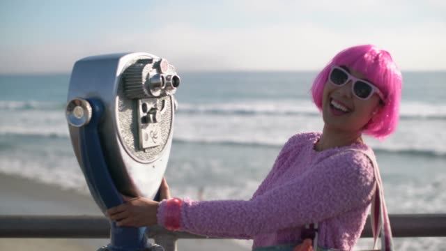 ms young woman with pink hair having fun on holiday - pink hair stock videos & royalty-free footage