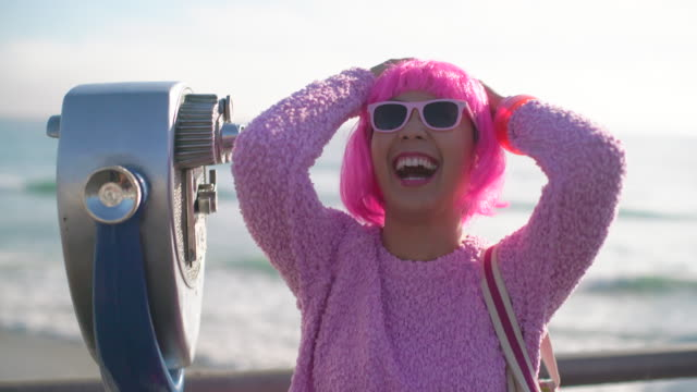 ms young woman with pink hair having fun on holiday - bangs stock videos & royalty-free footage