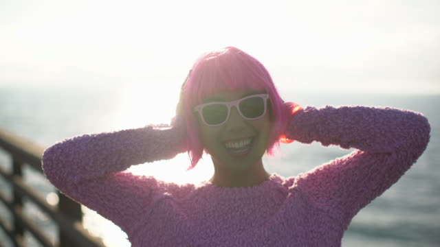 ms young woman with pink hair having fun - pink hair stock videos & royalty-free footage