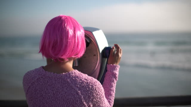cu rv young woman with pink hair looking through telescope - pink hair stock videos & royalty-free footage