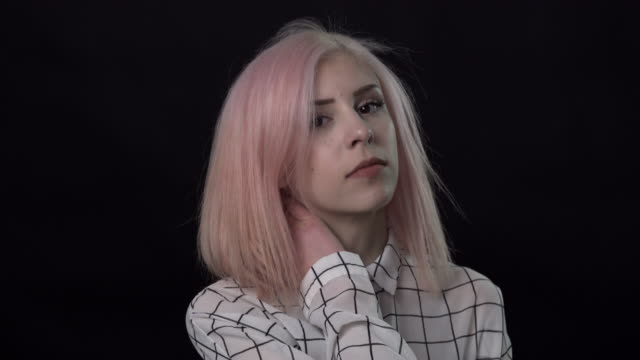 a young woman with pink hair shaking her head in rhythm with motion blur. - pink hair stock videos and b-roll footage