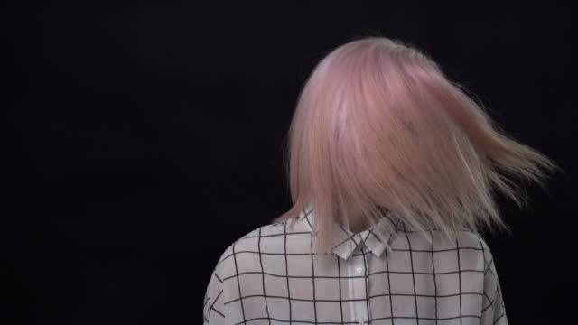 a young woman with pink hair shaking her head in rhythm with motion blur. - pink hair stock videos & royalty-free footage