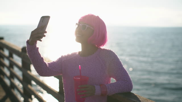ms young woman with pink hair taking a selfie - pink hair stock videos & royalty-free footage