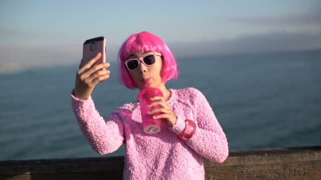 ms young woman with pink hair taking a selfie - hot pink stock videos & royalty-free footage