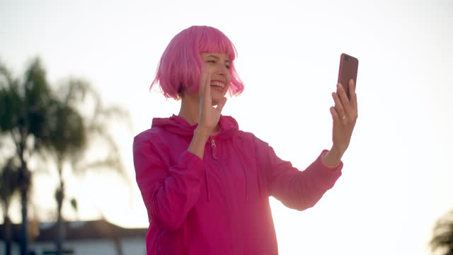 young woman with pink hair vlogging on her phone - pink hair stock videos & royalty-free footage