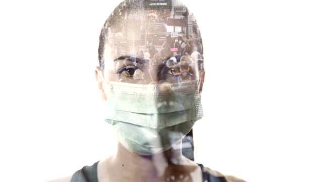 stockvideo's en b-roll-footage met ms young woman with protective face mask superimposed over crowded background - operatiemasker