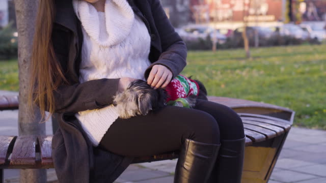 Young woman with puppy outdoors