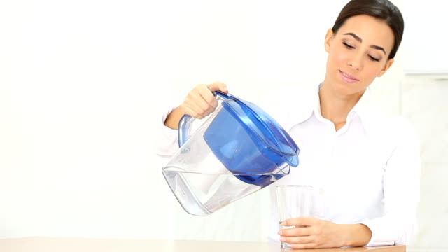 young woman with purified water - pitcher jug stock videos & royalty-free footage