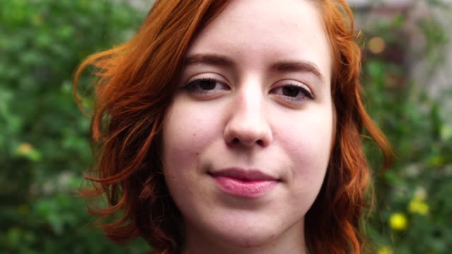 young woman with red hair portrait - short hair stock videos & royalty-free footage