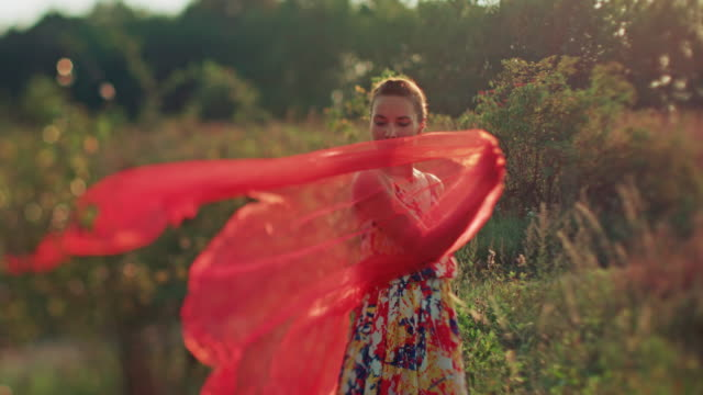 young woman with red shawl - dress stock videos and b-roll footage