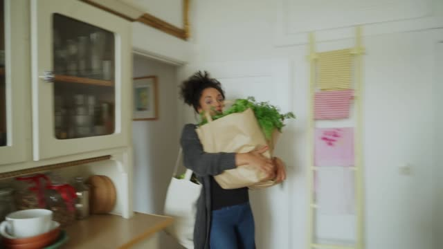 young woman with shopping in kitchen - reusable bag stock videos & royalty-free footage
