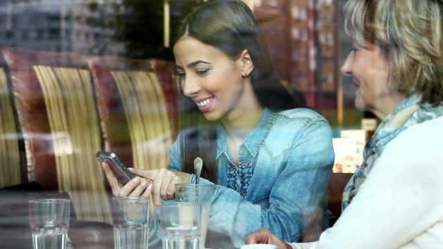 young woman with smart phone - adult offspring stock videos & royalty-free footage